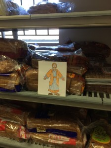 Flat Jesus prepares to serve bread at St. Martin's Food Pantry